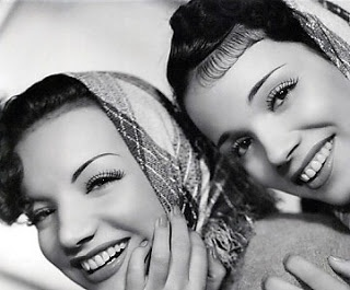 "Carmen & Aurora Miranda. Carmen Miranda was nicknamed ""The Brazilian Bombshell"" noted for her signature fruit hat outfit, by 1945, she was the highest paid woman in the United States. Her sister Aurora appeared in several films & in 1934 recorded a song about the ""marvellous city"" of Rio de Janeiro, ""the heart of my Brasil"". The song was to become the official Rio hymn, and its title became the nickname for Rio."