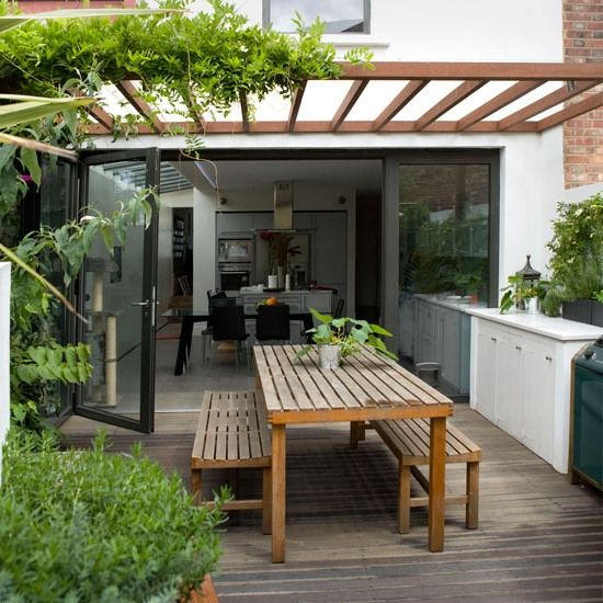 Outdoor Room With Wooden Table and Bench