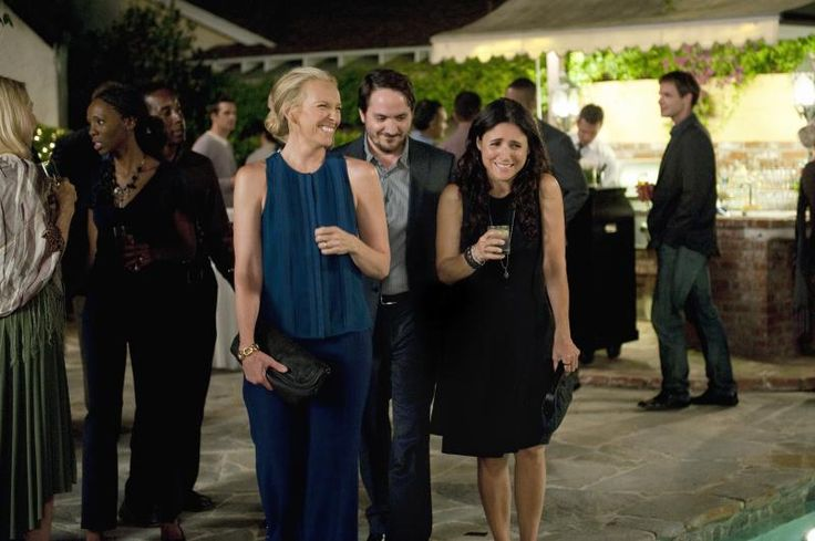 "Toni Collette as ""Sarah,"" Ben Falcone as ""Will"" and Julia Louis-Dreyfus as ""Eva"" in ENOUGH SAID"