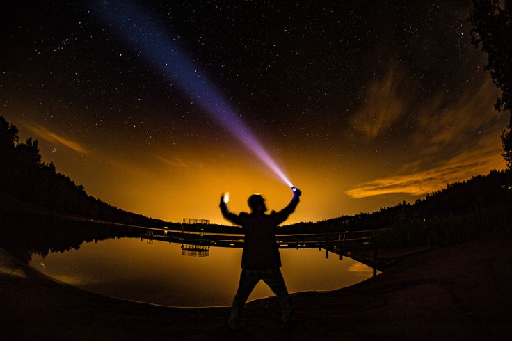 Stars night photography and me holding a flashlight somewhere in Finland