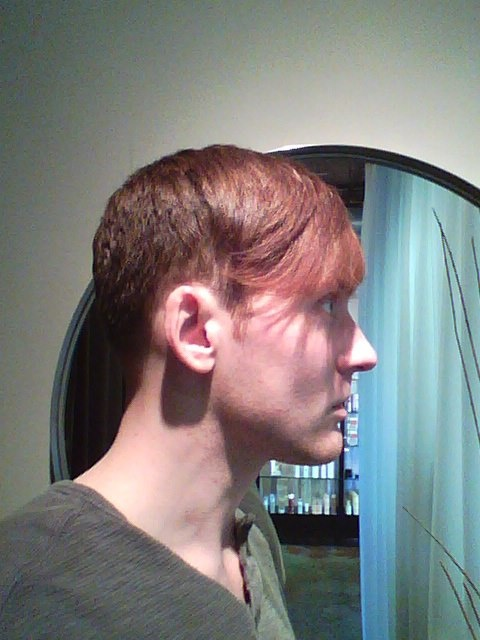 Disconnected Undercut Style With Long Bangs Men