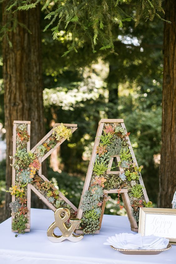 welcome table with succulent initial signs / / http://www.himisspuff.com/wedding-initials-letters-decor-ideas/7/