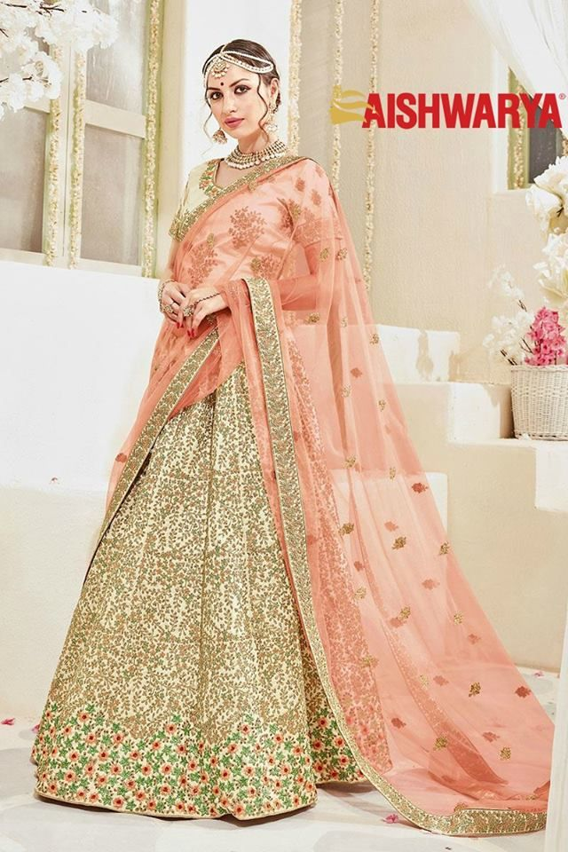 Glamorous new lehengas at now available in stores and online! Buy Lehenga online - http://www.aishwaryadesignstudio.com/enticing-cream-bridal-lehenga-choli-set