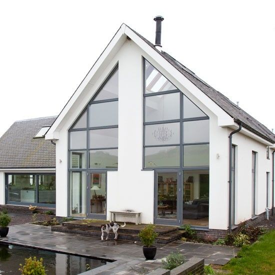 Glass-filled eco self-build  This environmentally friendly home was built using SIPs (Structural Insulated Panels) that offer increased energy efficiency. The windows were made in Denmark and supplied by ADW.