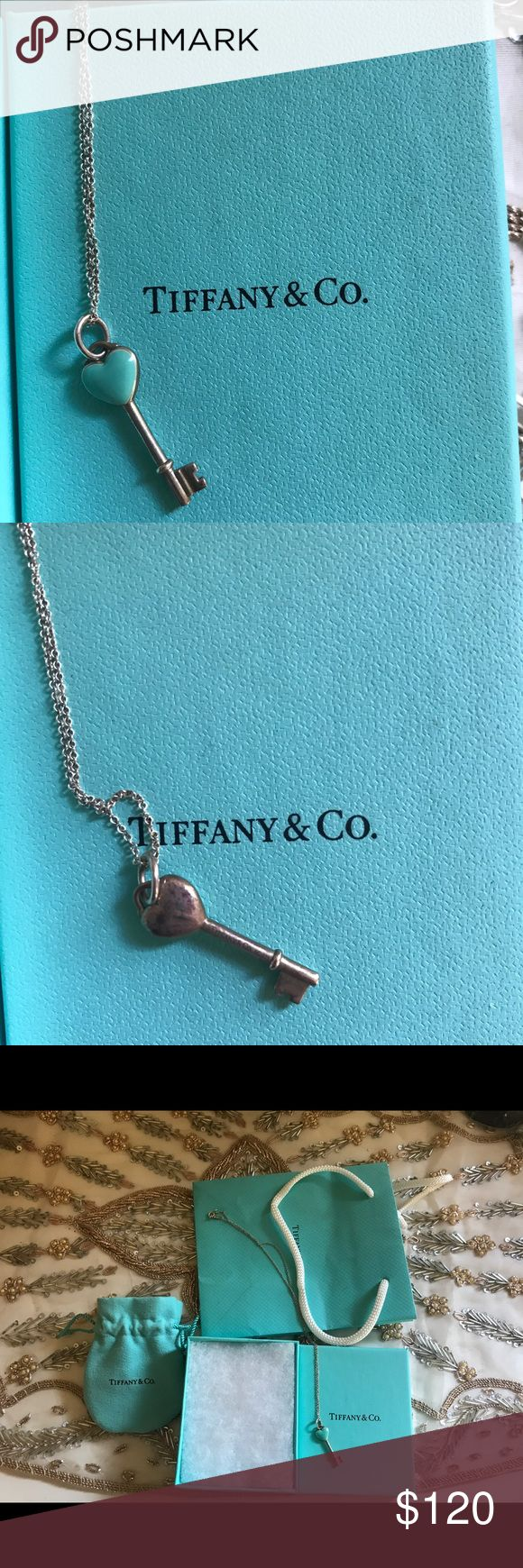 Tiffany Heart Necklace 💙 Gorgeous tiffanys necklace. Has been sitting in my jewelry drawer, in great condition. Only place you can see visible wear is on the back of the heart, shown in the second photo. The blue is still vibrant and beautiful. Excellent condition. Comes with pouch, box and bag. Tiffany & Co. Jewelry Necklaces