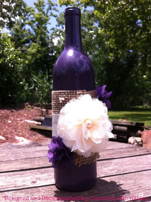 17 best images about centerpiece on pinterest sprays for Painted wine bottle wedding centerpieces
