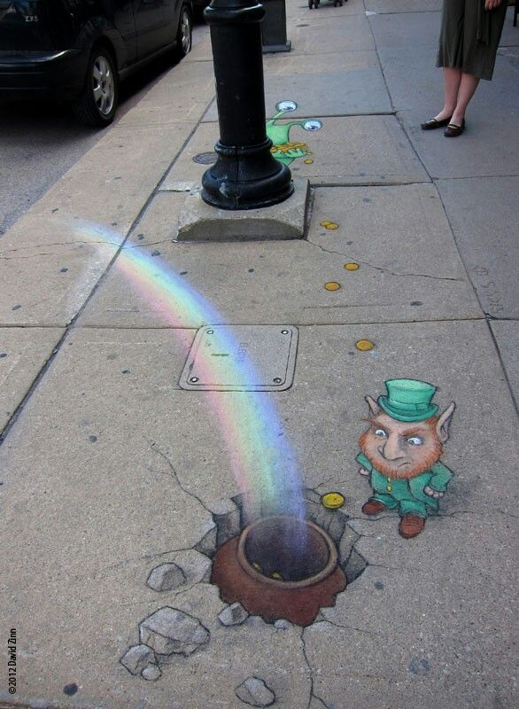 By David Zinn. His artwork pops up all over Ann Arbor, Mi.