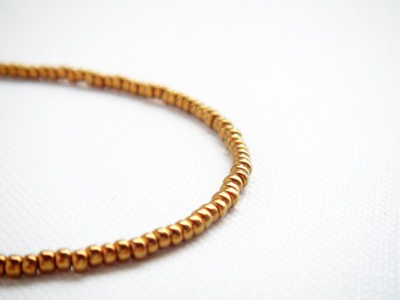 Gold bronze tiny beaded bracelet friendship by juditpukkai Use coupon code on Etsy: PIN10 to get 10% discount :-)