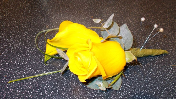 Yellow rose buttonhole