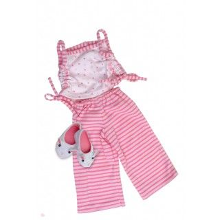 Perfectly Pink Pajamas: Brianne raises bunny rabbits, so what could be more suitable than bunny slippers to go with her two-piece pyjamas. On her journal pages, Brianne tells how she made a delightful cake in the shape of a bunny.