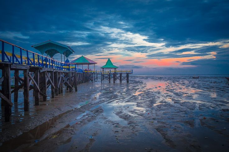 The Pier when the sea was receding by Kun Riyanto on 500px