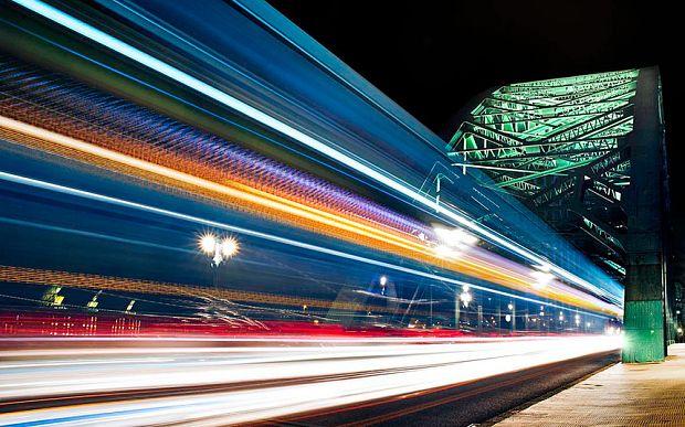 A long exposure shot of a bus 'whooshing' across the Tyne Bridge in Newcastle-upon-Tyne by photographer Karen Atkinson