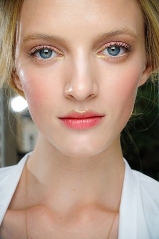 Play on textures: gold cupid's bow highlight + frosty stained lips at Valentino F11 CTR