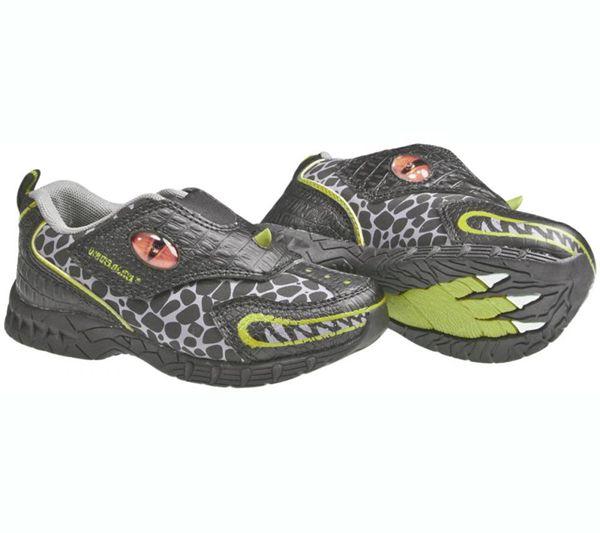 Increíbles deportivas de dinosaurio. Son fluorescentes y al andar, los ojos del dinosaurio se iluminan y dejan la huella de su dinosaurio favorito.  Color: Gris y verde  Ref. 30166 Precio: 36.00 € IVA incluido