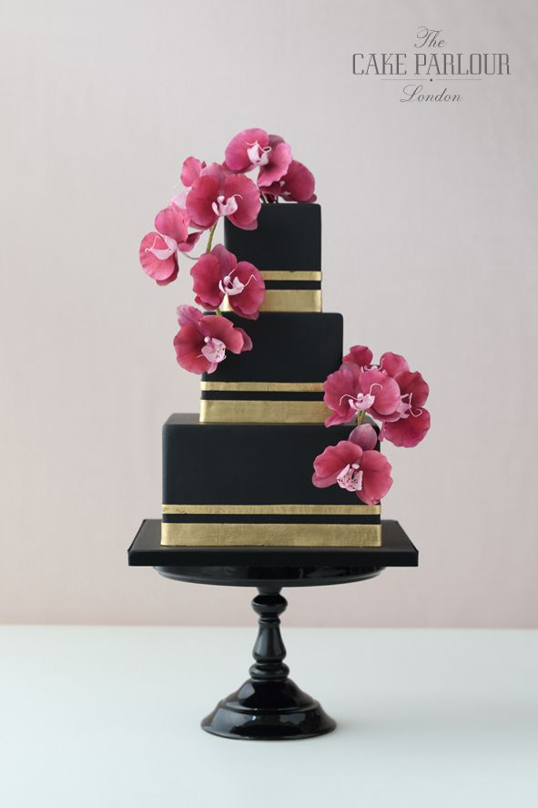 'SIMPLY STRIKING ORCHID' Wedding Cake - Sleek black iced square wedding cake with banded gold leaf and beautiful trailing handcrafted moth orchids.