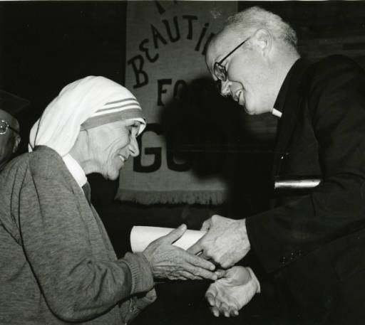 Photograph of Mother Teresa receiving the University of Scrantons La Storta Medal for Human Service from University president William J. Byron, S.J., ca. 1976.