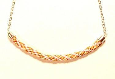 An amazing statement necklace made by combining colourful satin cords. Great conversation piece that will be sure to catch many eyes.   This listing is for a hand-braided necklace finished with anti-allergic chain and lobster clasp fastening.   The statement piece that can be combined with other necklaces or worn alone.