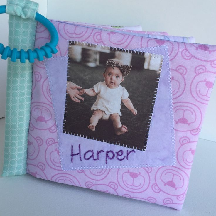 Little Harper has her very own photo album...a Cuddle Book with photos of her family, printed on softly padded cotton pages. Perfect!!