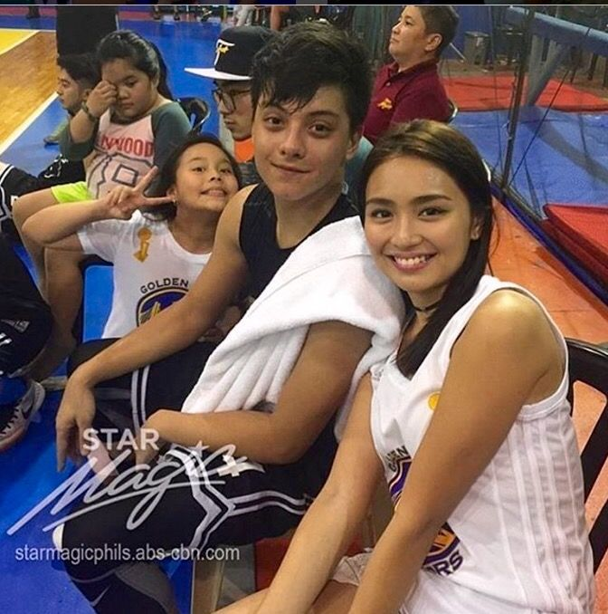 This is Kathryn Bernardo and Daniel Padilla smiling for the camera while getting ready for the Pangako Sa 'Yo Basketball Tournament after a day of taping of the remake of Pangako Sa 'Yo last February 18, 2016. Kathryn was cheering on for Daniel during the game; and they're very happy and enthusiastic! :-) #KathNiel #KathNielBernadilla #PangakoSaYo #PangakoSaYoBasketballTournament #Roborats #RoboratsBasketball
