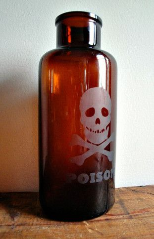 """The large amber bottle bears the rare character and timeworn beauty of a vintage piece. Featuring an etched skull and the word """"POISON"""" this bottle would make a perfect addition to any Halloween décor"""
