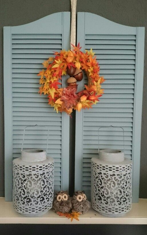 Painted shutters and autumn wreath