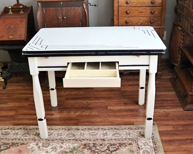 """Antique Porcelain Enamel Top Farm Table Desk Expandable with Art Deco Design / Rustic / Shabby. Table top is 25"""" x 40"""" with sides down and 45"""" x 40"""" with sides up. Table is 31in tall and comes with some nicks and blemishes.   eBay!"""