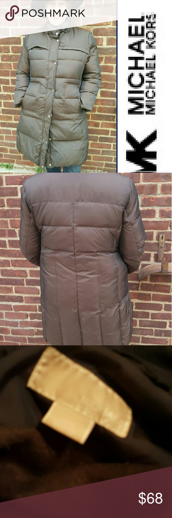 Michael Michael Kors Puffer coat XL CMon deal The coat is in great condition. It does not have a hood and there's a large hole in one pocket . super warm and as you can see true to size. Do not bundlel with items over 5 pounds. 17 inches shoulder to shoulder approximately 2221 under arms and 37 inches long. MICHAEL Michael Kors Jackets & Coats Puffers
