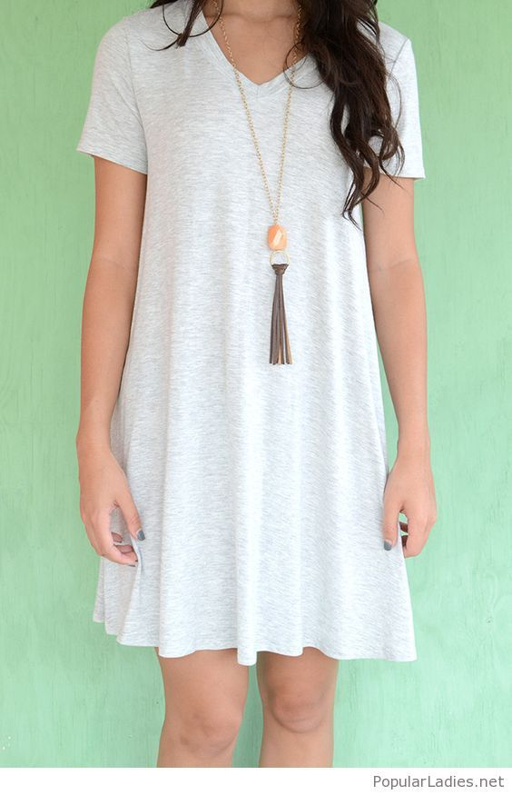 Simple A-line white T-shirt with a long necklace