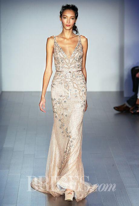 An stunning beaded column @lazarobridal wedding dress | Brides.com