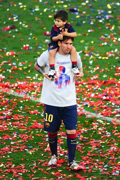 Lionel Messi of FC Barcelona carries his son Thiago during celebrations at the end of the La Liga match between FC Barcelona and RC Deportivo de la Coruna at Camp Nou on May 23, 2015 in Barcelona, Spain.