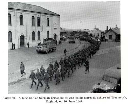 """""""A Long line of German prisoner of War being marched ashore at Weymouth England 10 June 1944"""