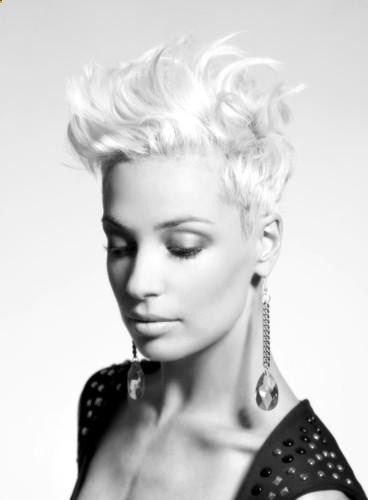 Want to shorten my sides like this.... Intercoiffure Artistic Team - Hairstyle 2013 Luxury short cuts: glamorous and casual. Accurate geometrical cuts gain star-appeal with artistic hair-tattoos and feminine fringes of curls. Coolness meets elegant design. The new Dandy looks combine masculine cuts with wonderfully feminine texture. Chocolate shade and blond power as nuanced color statements. Clean chic for TREND. .