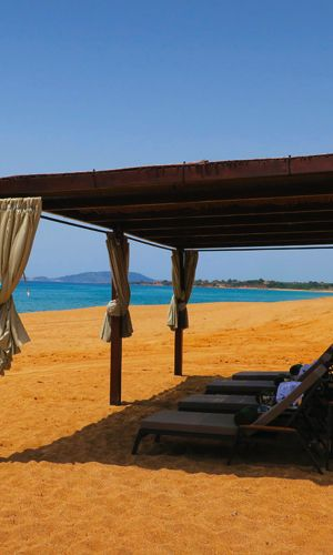 The beach at The Romanos, a Luxury Collection Resort in Costa Navarino, Greece