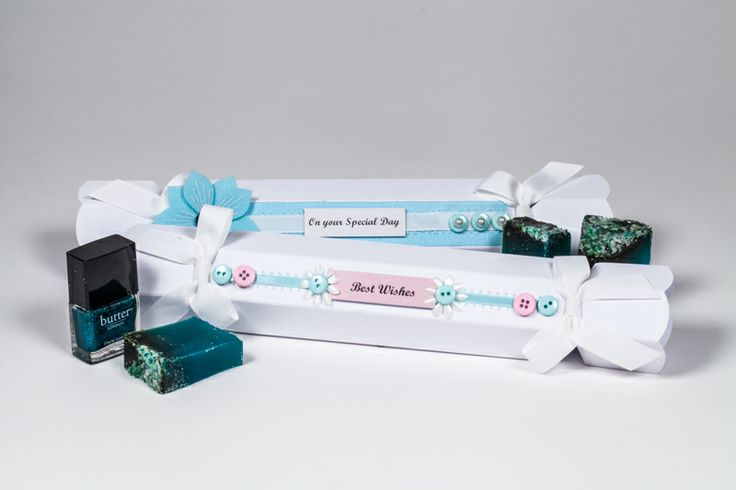 White celebration crackers with custom decorations. Perfect for soaps and nail polish gift packaging. www.foldabox.co.uk