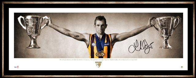 HAWTHORN FOOTBALL CLUB LUKE HODGE WINGS Iconic image of Hawthorn's Premiership Captain Luke Hodge with Hawthorn's 2008 and 2013 Premiership Cups and his 2008 Norm Smith Medal Personally signed by Luke Hodge Presented in a deluxe timber frame Officially licensed by the AFL Authenticated by the AFL Player's Association Accompanied with a certificate of authenticity Approx framed size 1350mm x 570mm