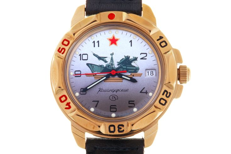 WATCH VOSTOK KOMANDIRSKIE SOVIET GUARDS. At the top of the watch face there is a red five-pointed star with a wide goldish edging. In the central part is a figured image of the black and orange Guards ribbon with military equipment of the main types of troops placed over it. #russian #mechanical #military #watches #vostok #komandirskie #gifts #souvenirs #aircraft #missile #warship