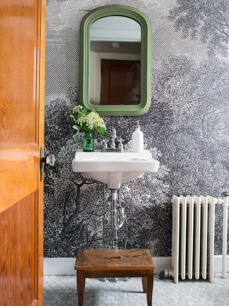 The bathroom and powder room decorating experts at HGTV.com share step-by-step instructions for hanging a graphic wallpaper in your bathroom.