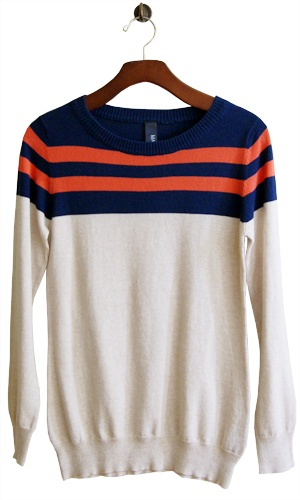 A favorite for chilly days, this fresh orange and navy stripes liven up a soft taupe sweater, adding new-again vintage appeal.