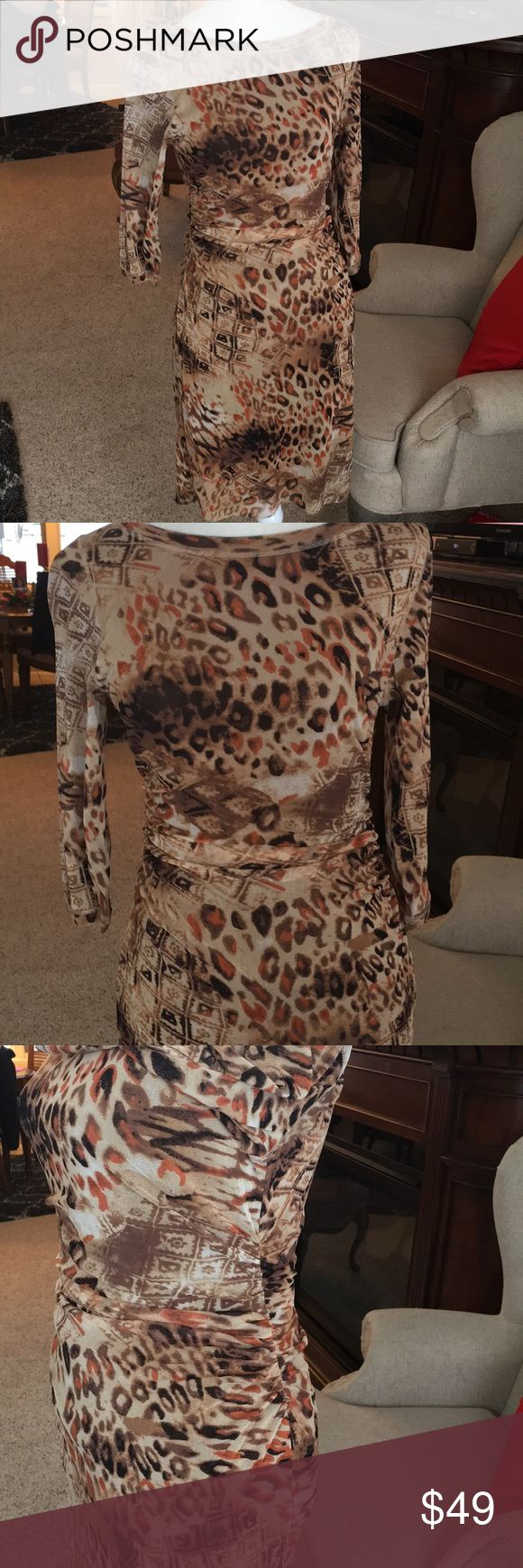 Kay Unger multi print half sleeved dress Brown tones, half sleeves dress from Kay Unger. Knee length. Dress has 3 layers of material. Rouching along the sides makes this a very flattering dress. Kay Unger Dresses