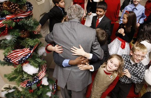 President George W. Bush is smothered in little hands as he says goodbye to a group of children in attendance Monday, Dec. 8, 2008, for the Children's Holiday Reception and Performance at the White House. The President and Mrs. Laura Bush traditionally invite children to a White House celebration for the holidays, and this year, the audience included kids of active duty and reserve military service members from Russell Elementary at Quantico Marine Base, Dahlgren School at Dahlgren Navy…