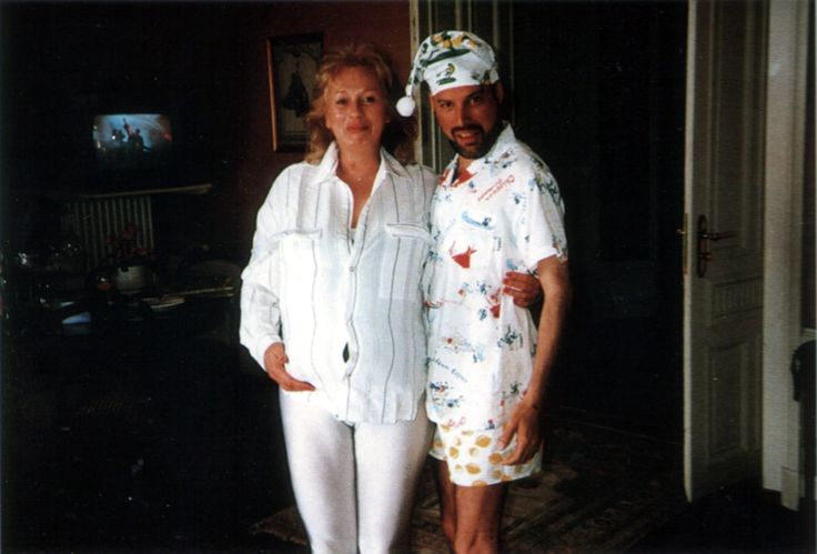 Freddie with Barbara Valentin this night when  Fred wrote song about his cat Delilah. Barbara bought him pijamas and nightcap in Miki & Minnie when they came back from Mountain Studios in Montreux,1990. They were also there, Jim and Joe.