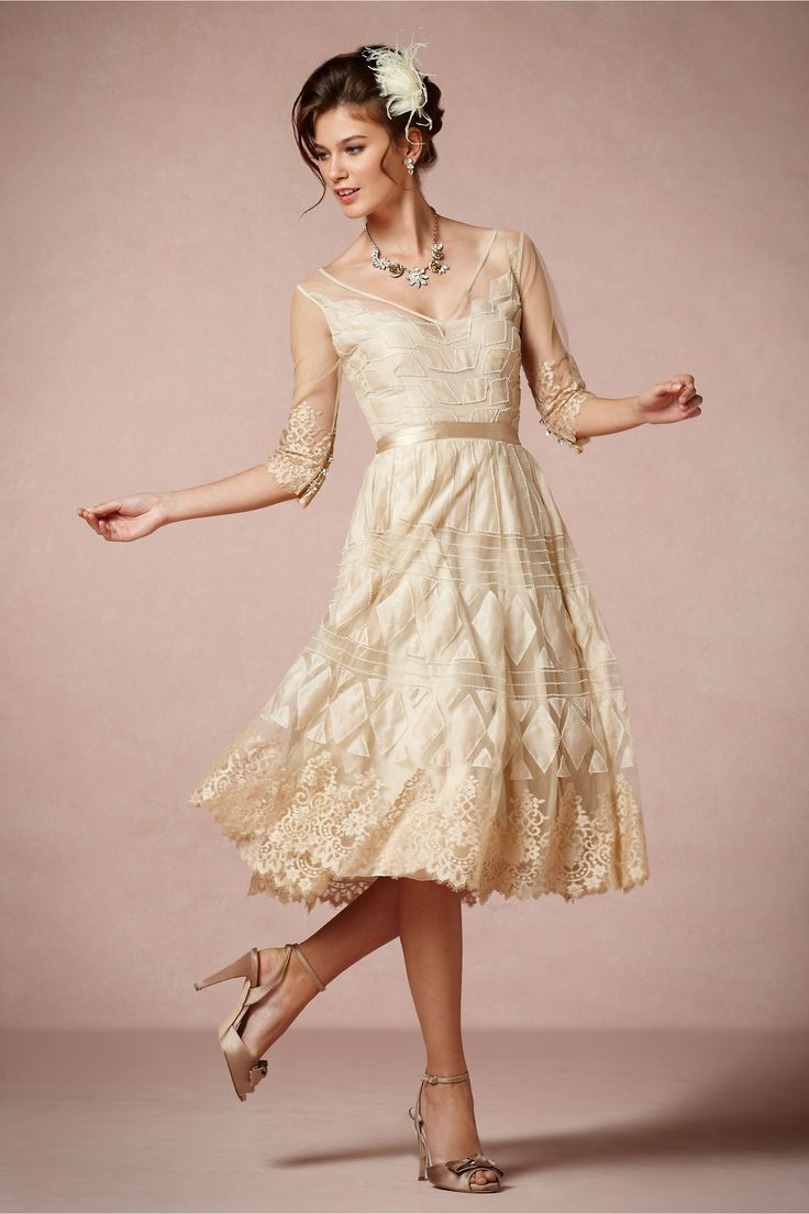 Charm School Dress from BHLDN  This is a pretty tea dress! I'd add a bit more on the top of course. Other then that it's a perfect feminine dress. :)