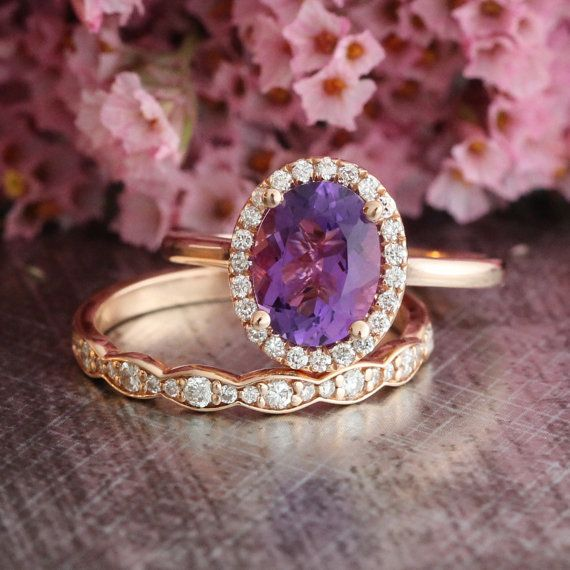 This amethyst wedding ring set showcases a halo engagement ring with a 9x7mm oval shaped natural purple amethyst crafted in a solid 14k rose gold
