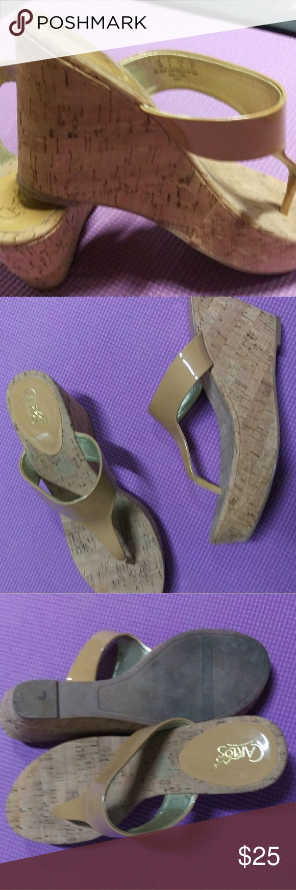 Carlos cork wedge tan thong sandals size 10 Carlos cork wedge sandals, worn a couple times. Summer here in Montana is over so away these go. Bottoms are a little dirty but I'll wash em up. No damage or scuffs. These go with anything! Carlos Santana Shoes Platforms