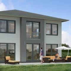 Eine Stadtvilla günstig schlüsselfertig bauen: klassische Häuser von SI-Massivhaus