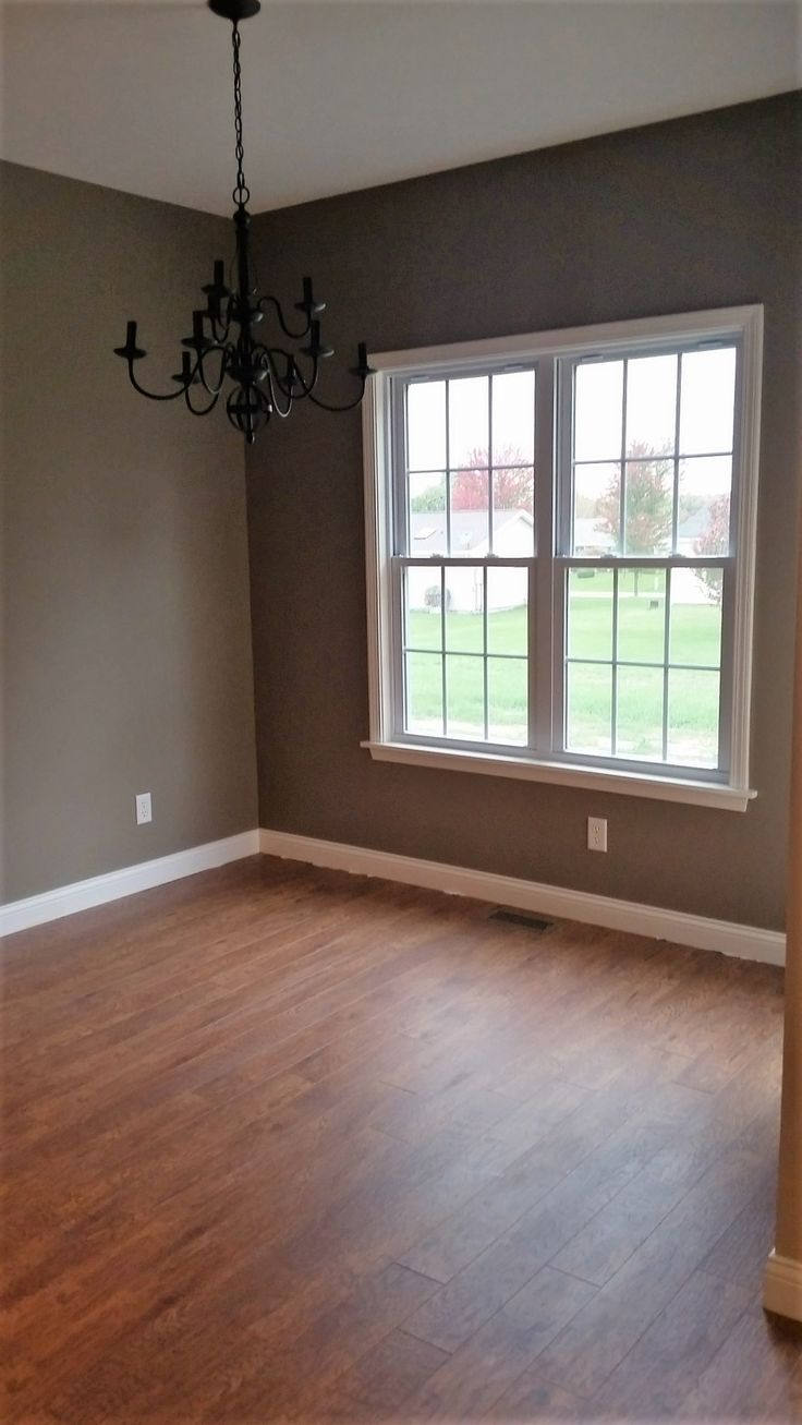 Laminate wood flooring on wall - We Love The Laminate Wood Floors With The Wide White Baseboard And Oil Rubbed Bronze