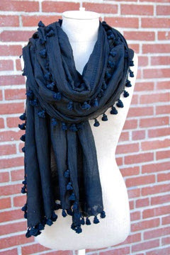 "Black Tie Fashion Scarf  - You'll turn heads as with this ""little black dress"" of the scarf world. This noir stunner will add class to any outfit while instantly adding a healthy dose of timeless chic. Whether you want to add some elegance to a basic tee, or cover your shoulders when wearing an evening gown, this fashionable scarf is ideal for a woman who leans toward a classic, sophisticated taste."
