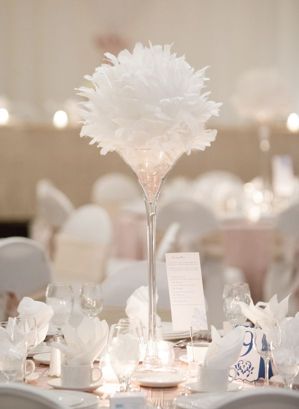 Feathers in tall glass vase for wedding centerpiece