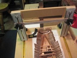 Model Ship Building Board - Homemade gantry-type building board intended for model ships. Constructed from particle board, aluminum T-track, and hardware.