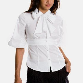 white bow tie blouse with bell shaped sleeves (from Armani, I think). I like the bow and the waistband. The sleeves...maybe not so much :)